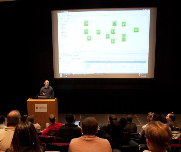 James-Standen-presenting-datamartist-to-the-crowd-at-democamp-toronto